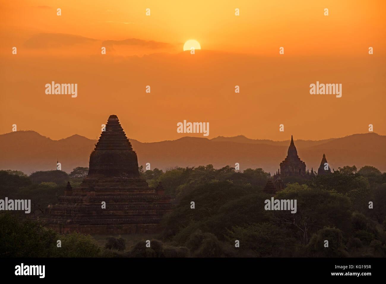 Buddhist temples and pagodas at sunset in the ancient city Bagan / Pagan, Mandalay Region, Myanmar / Burma - Stock Image