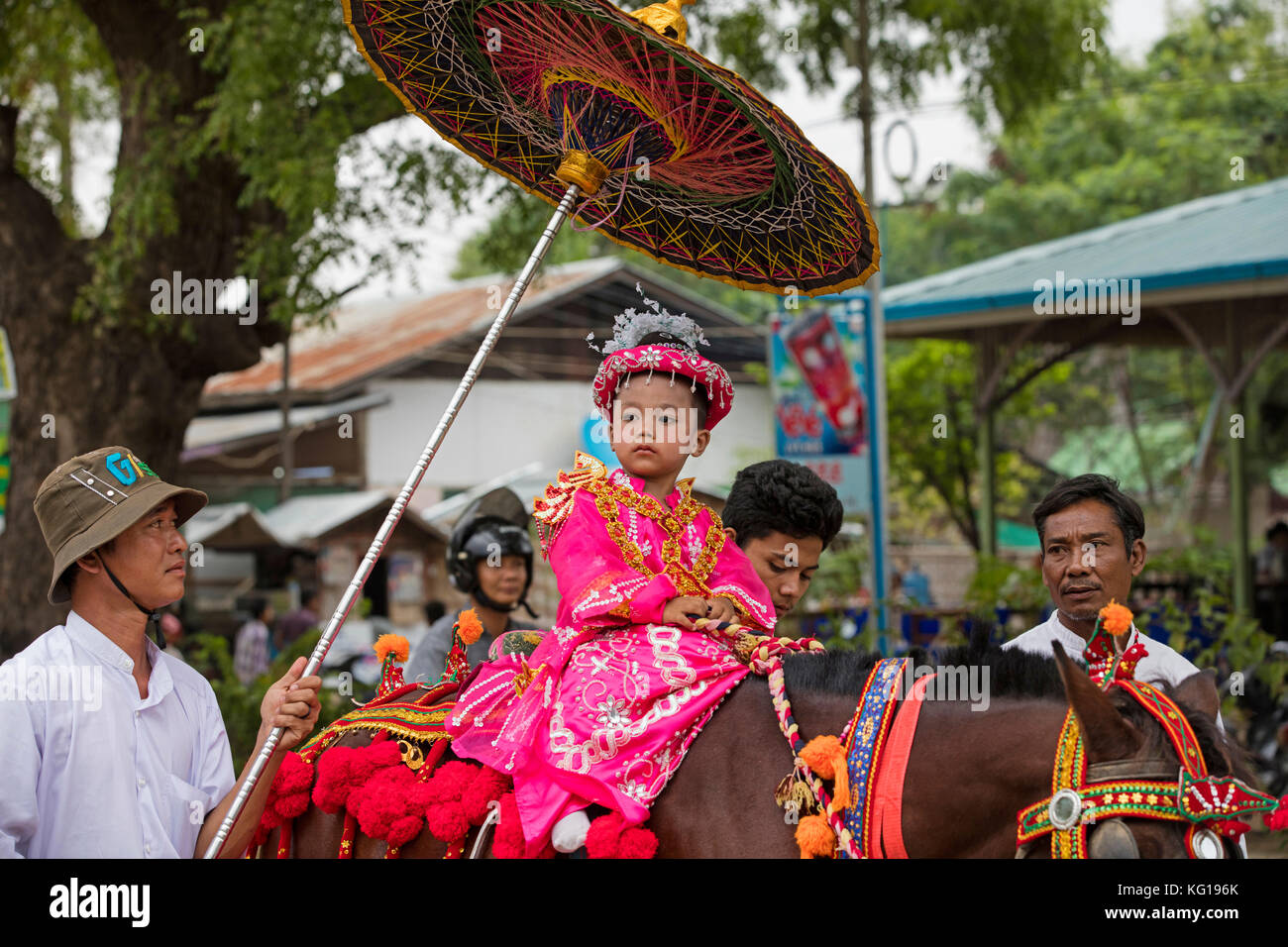 Traditional parade for Burmese child becoming a novice monk in the city Bagan / Pagan, Mandalay Region, Myanmar - Stock Image