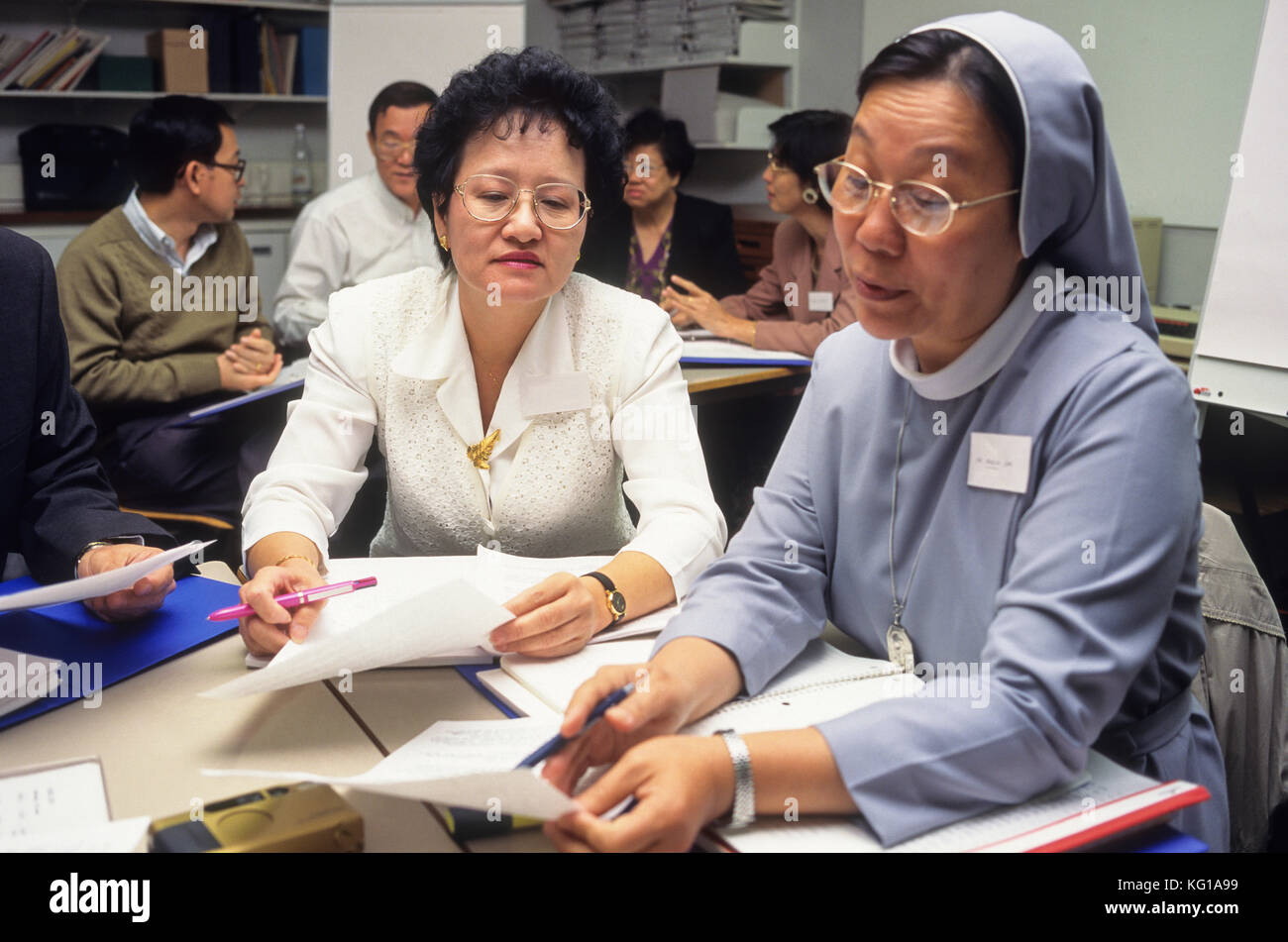 Mature students in class, university - Stock Image