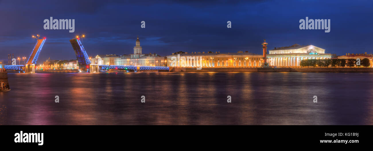 Night panoramic view on illumunated open Palace Bridge, Neva River and Old Stock Exchange, St. Petersburg, Russia - Stock Image