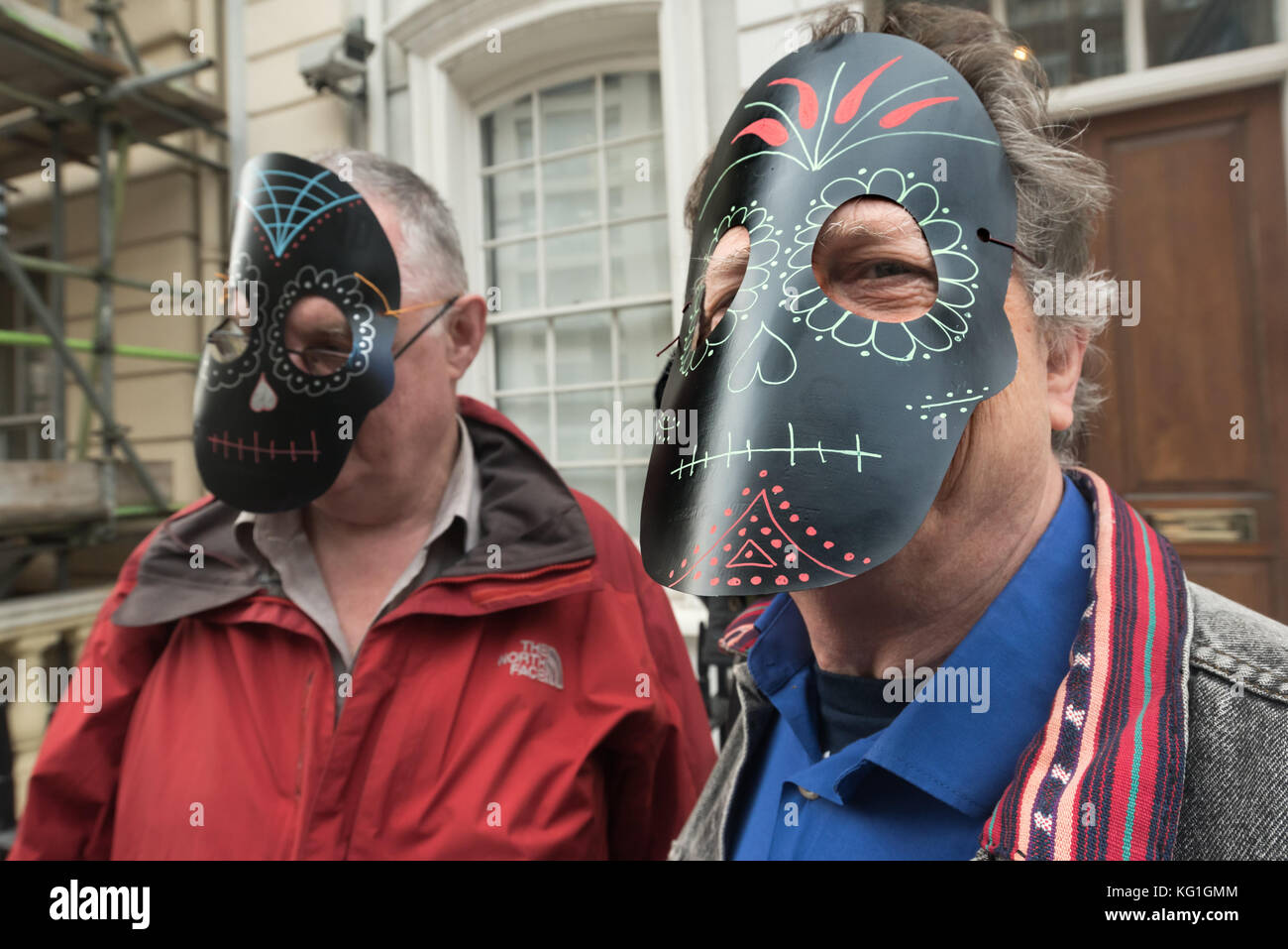 London, UK. 2nd November 2017. Men wear Mexican decorated masks at the Justice Mexico vigil at the Mexican Embassy Stock Photo