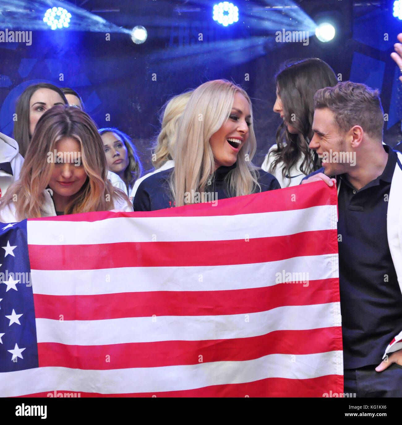 Times Square, New York, NY. Team USA teammates Amy Purdy, Linsey Vonn, and Gus Kenworthy had a great time holding - Stock Image