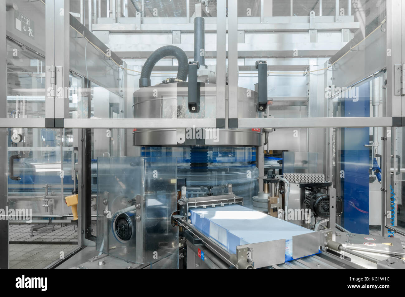 for the production of plastic bottles and bottles on a conveyor belt factory - Stock Image