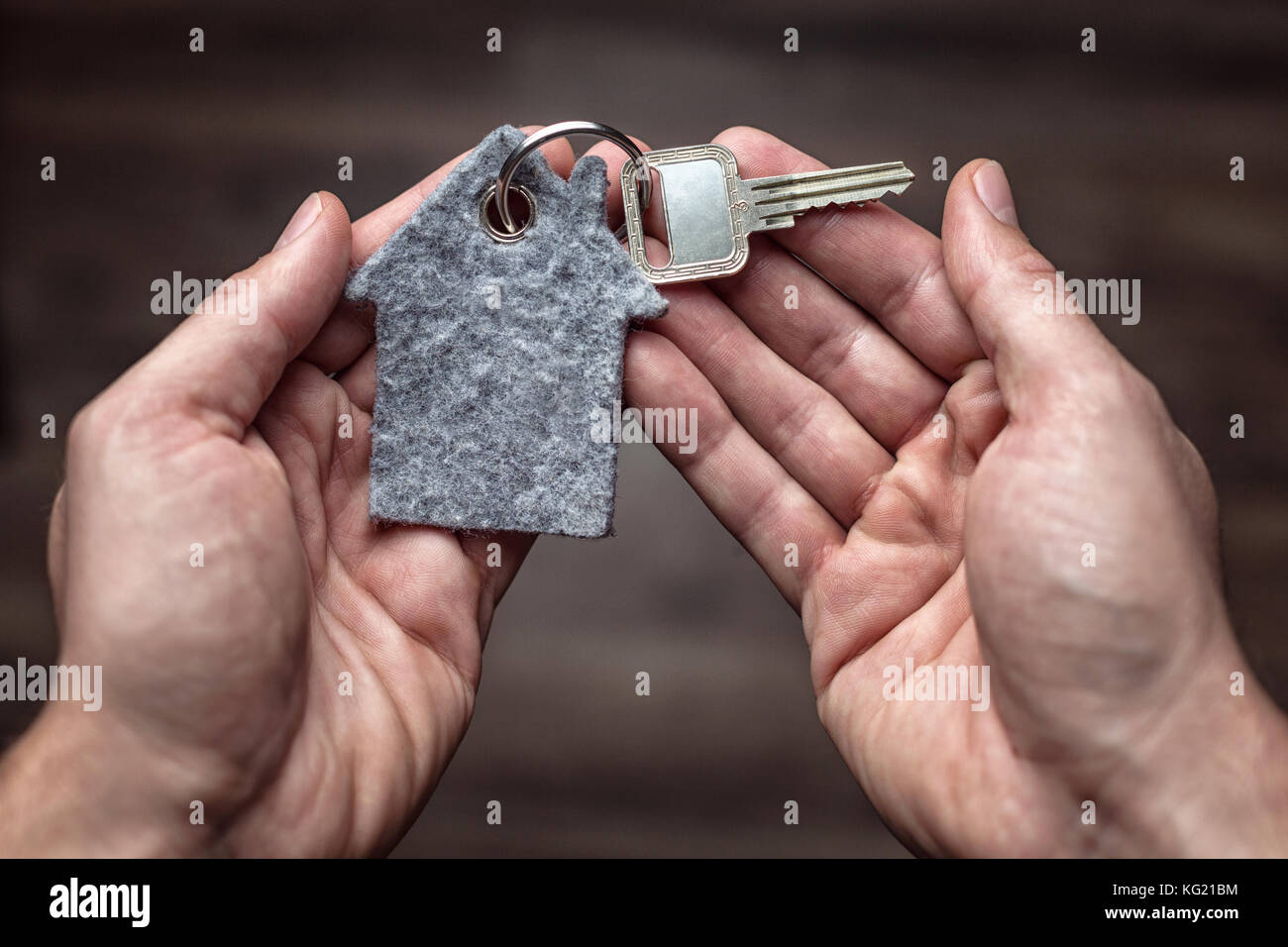 Latchkey in both hands - Stock Image