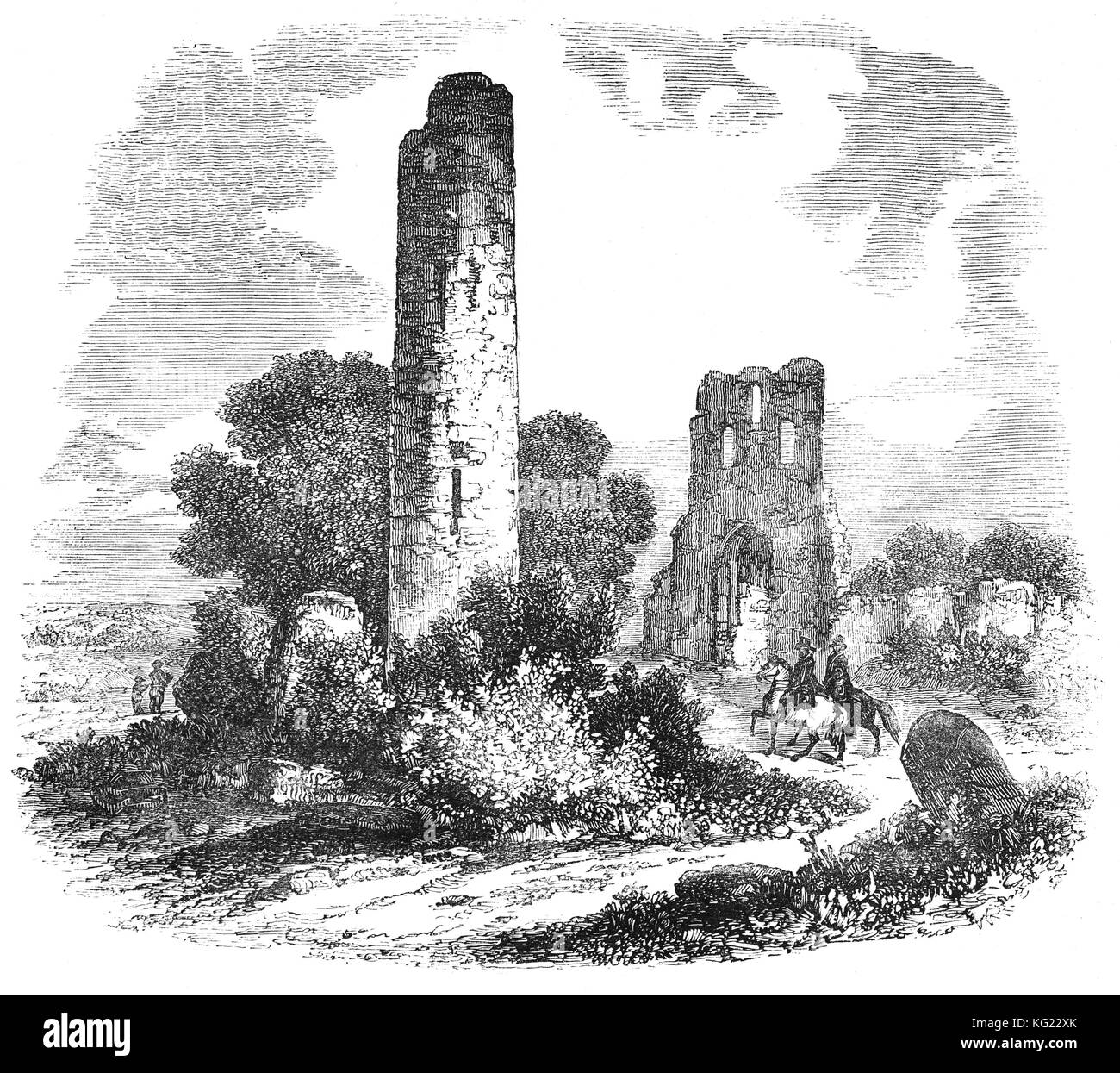 Donaghmore Round Tower was built in the 9th or 10th century. It is well-preserved though missing its conical cap. - Stock Image