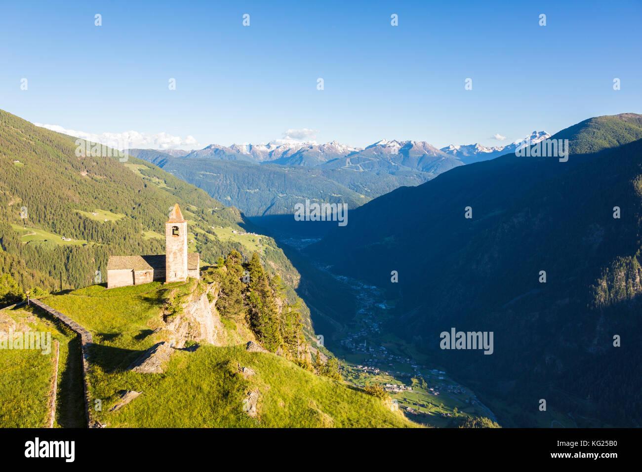 Ancient church perched on mountains, San Romerio Alp, Brusio, Canton of Graubunden, Poschiavo Valley, Switzerland, - Stock Image