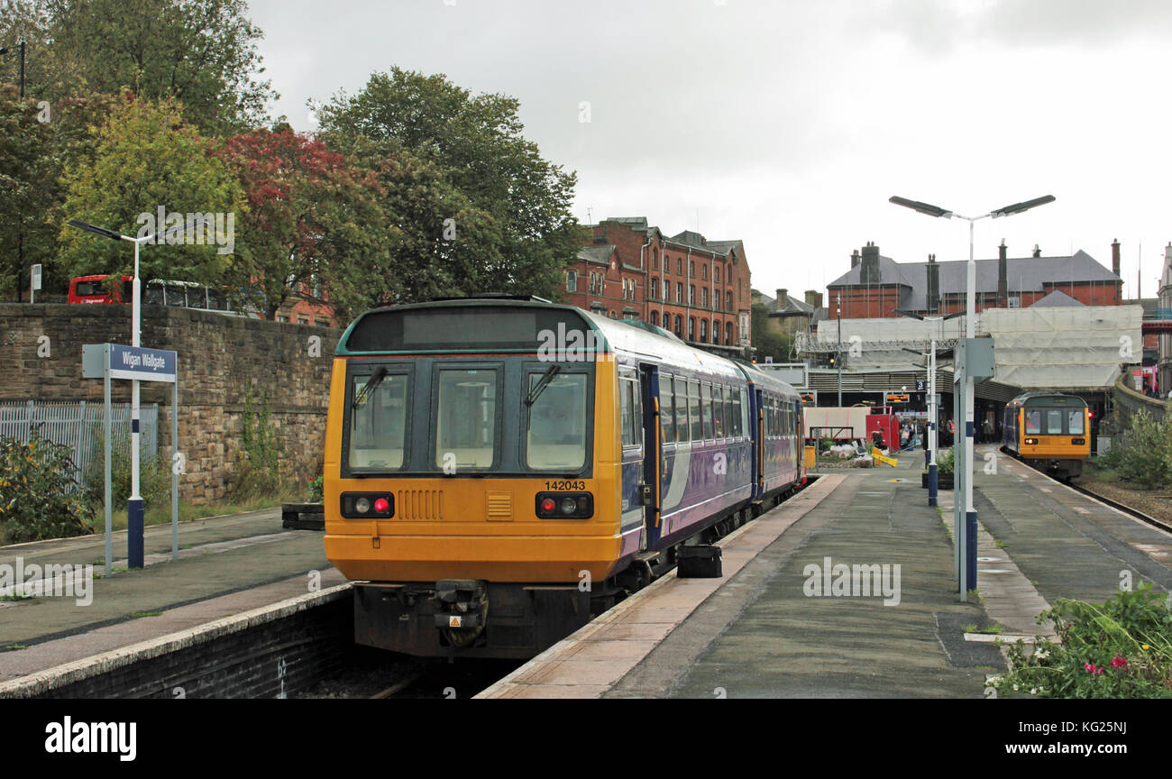A Northern Railway train stands in the bay platform at Wigan Wallgate station in Greater Manchester before working - Stock Image