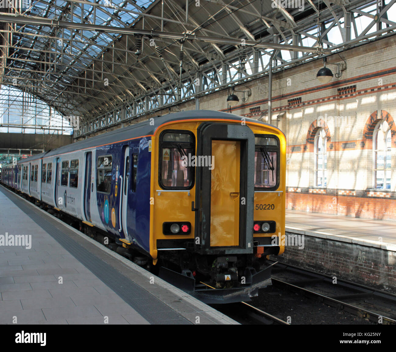 A Northern Railway recently refurbished and repainted train stands in platform two at Manchester Piccadilly before - Stock Image