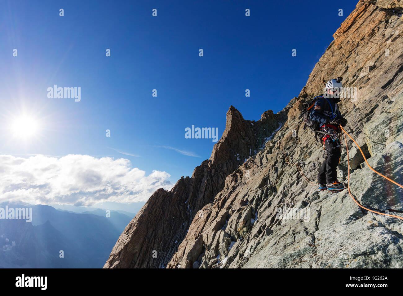 Climber on south ridge of Dent Blanche, 4357m, Valais, Swiss Alps, Switzerland, Europe - Stock Image