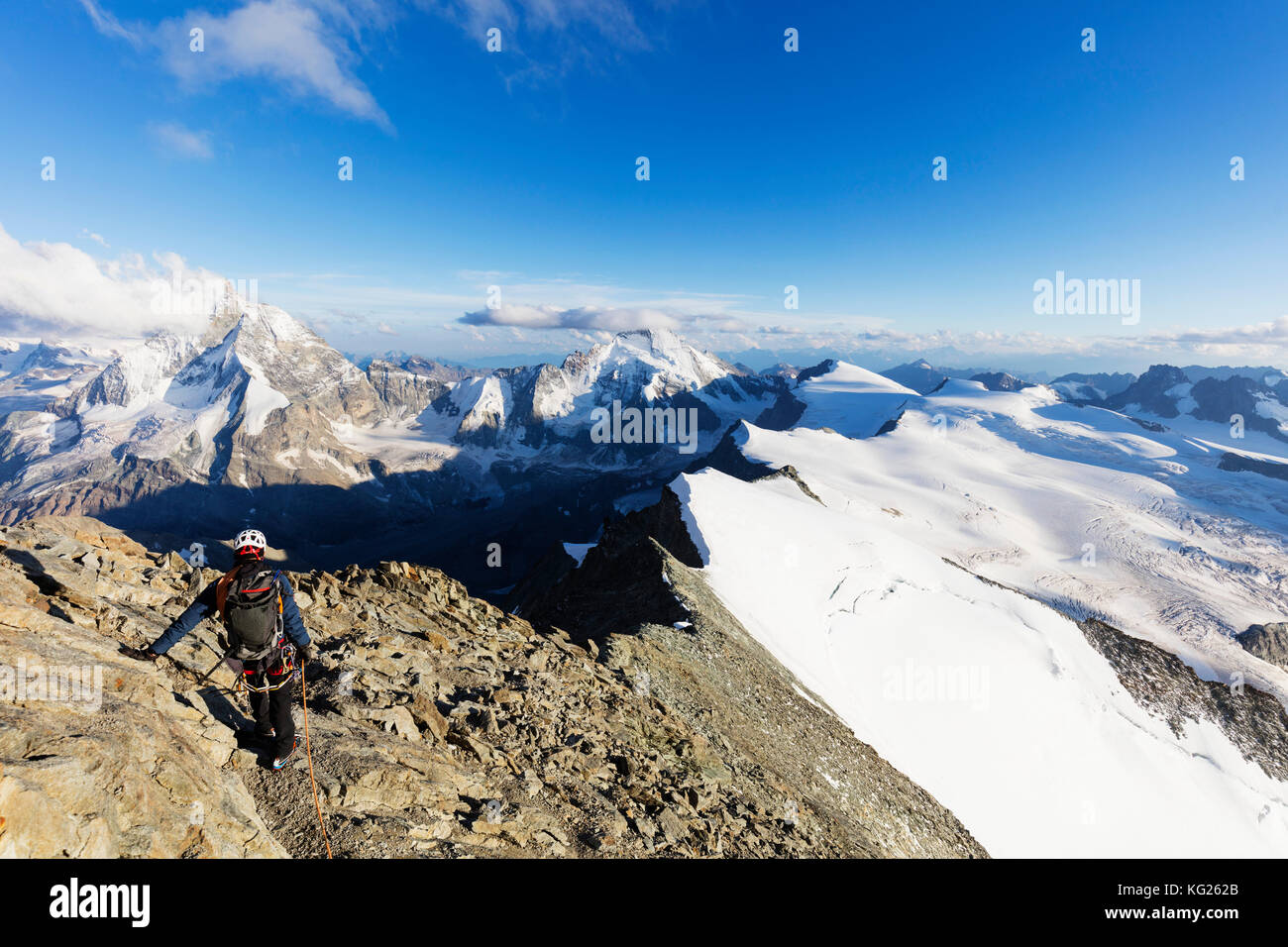 Climber on south ridge of Dent Blanche, 4357m, with view to the Matterhorn, Valais, Swiss Alps, Switzerland, Europe - Stock Image
