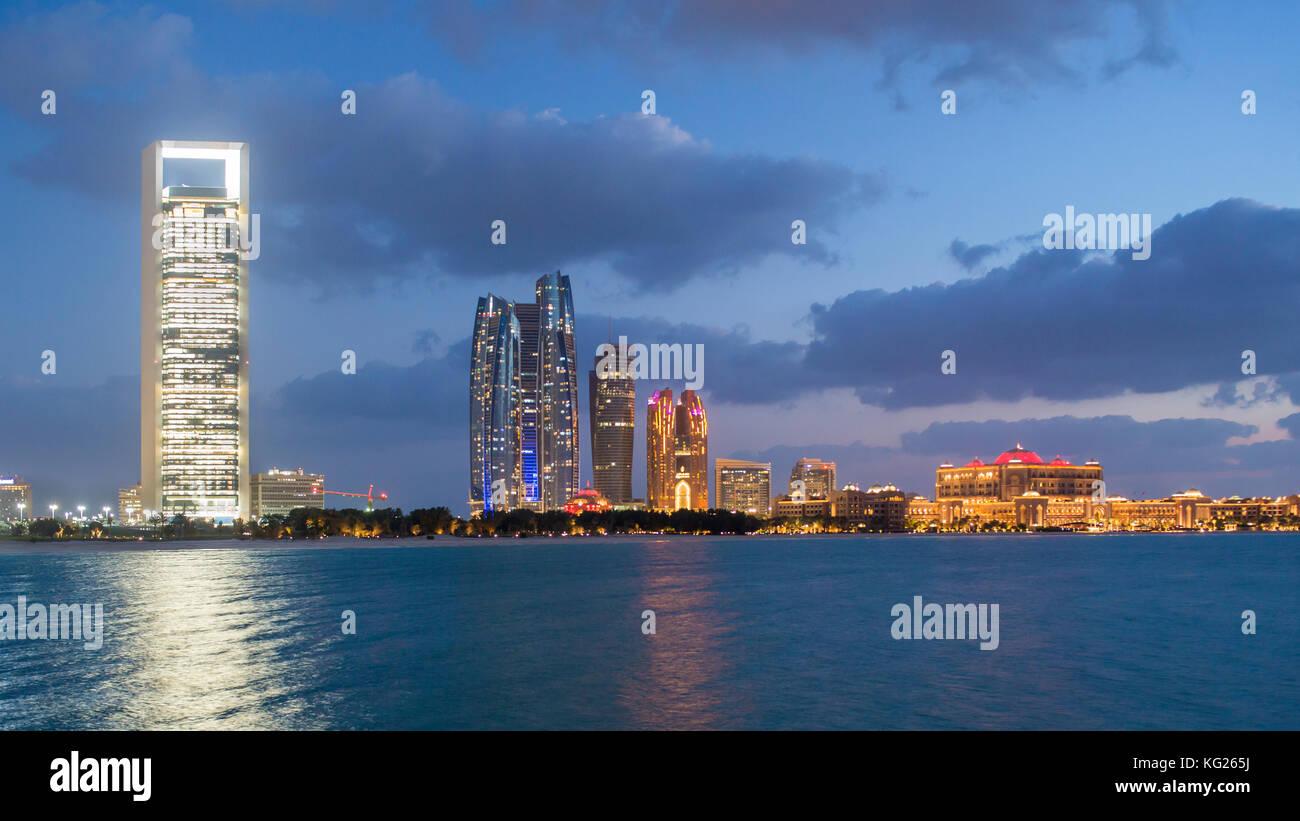 Etihad Towers and Emirates Palace hotel viewed from the Breakwater, Abu Dhabi, United Arab Emirates, Middle East - Stock Image