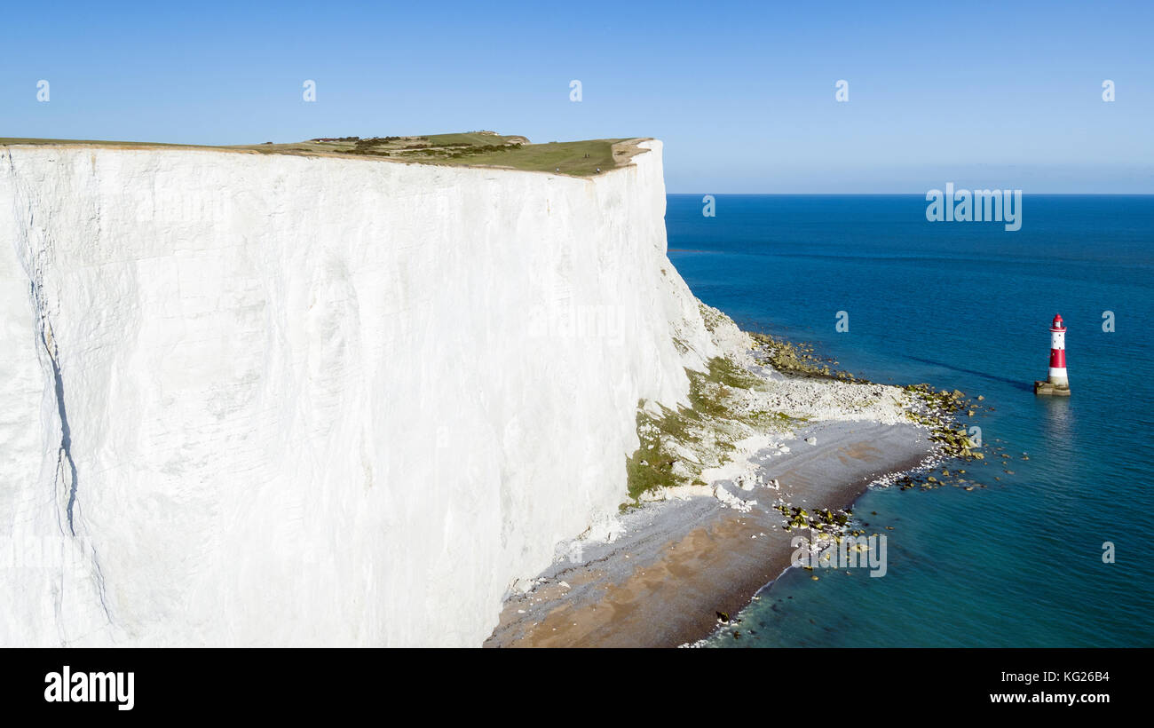 White chalk cliffs of Beachy Head and lighthouse, South Downs National Park, near Eastbourne, East Sussex, England, Stock Photo