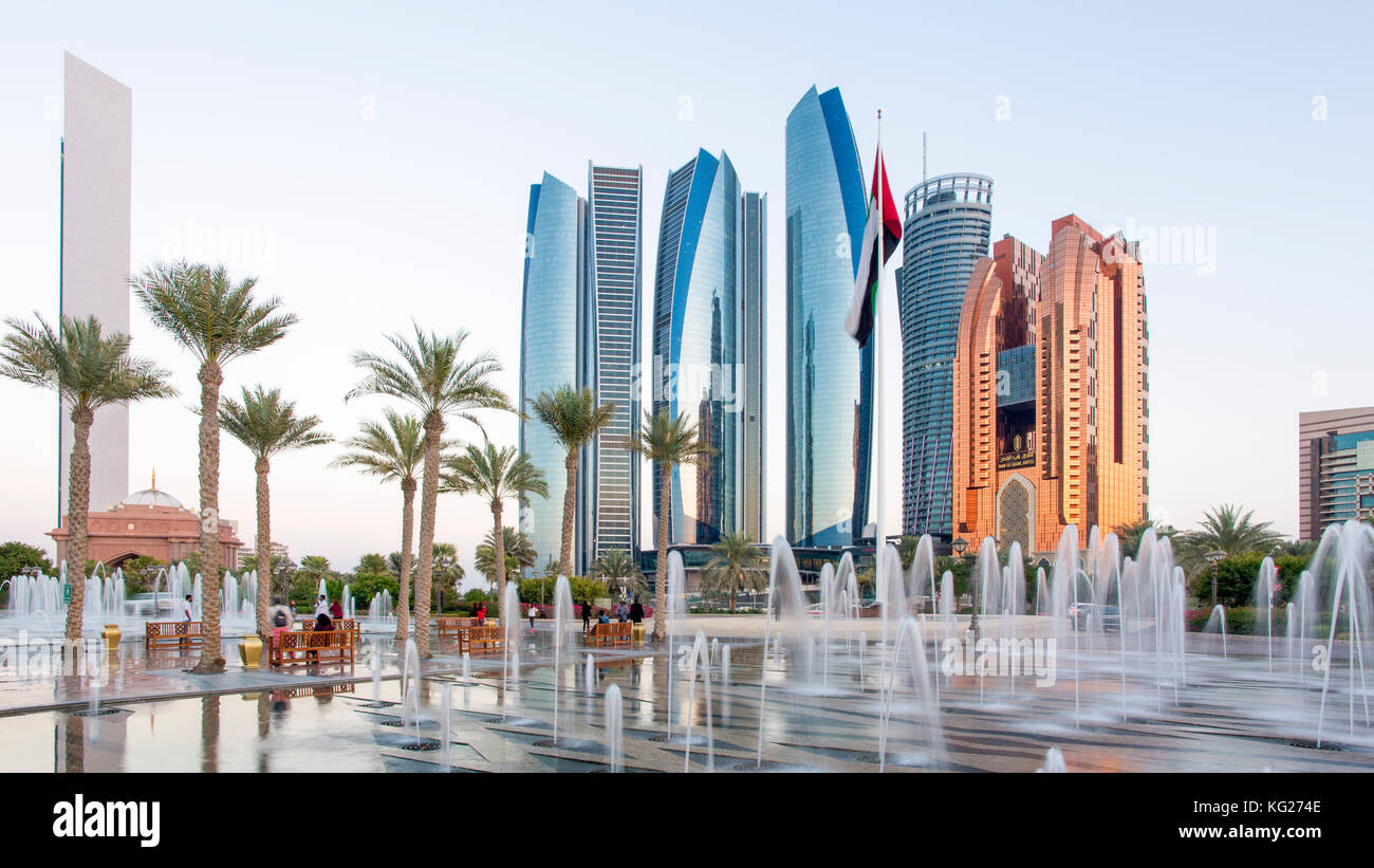 Etihad Towers viewed over the fountains of the Emirates Palace Hotel, Abu Dhabi, United Arab Emirates, Middle East - Stock Image
