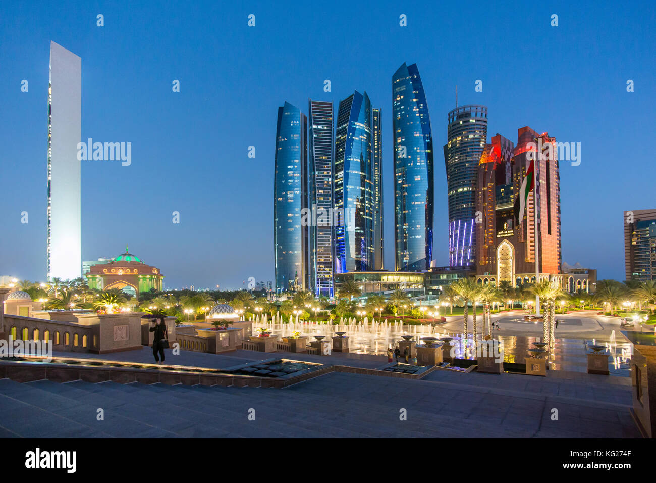 Etihad Towers viewed over the fountains of the Emirates Palace Hotel, Abu Dhabi, United Arab Emirates, Middle East Stock Photo