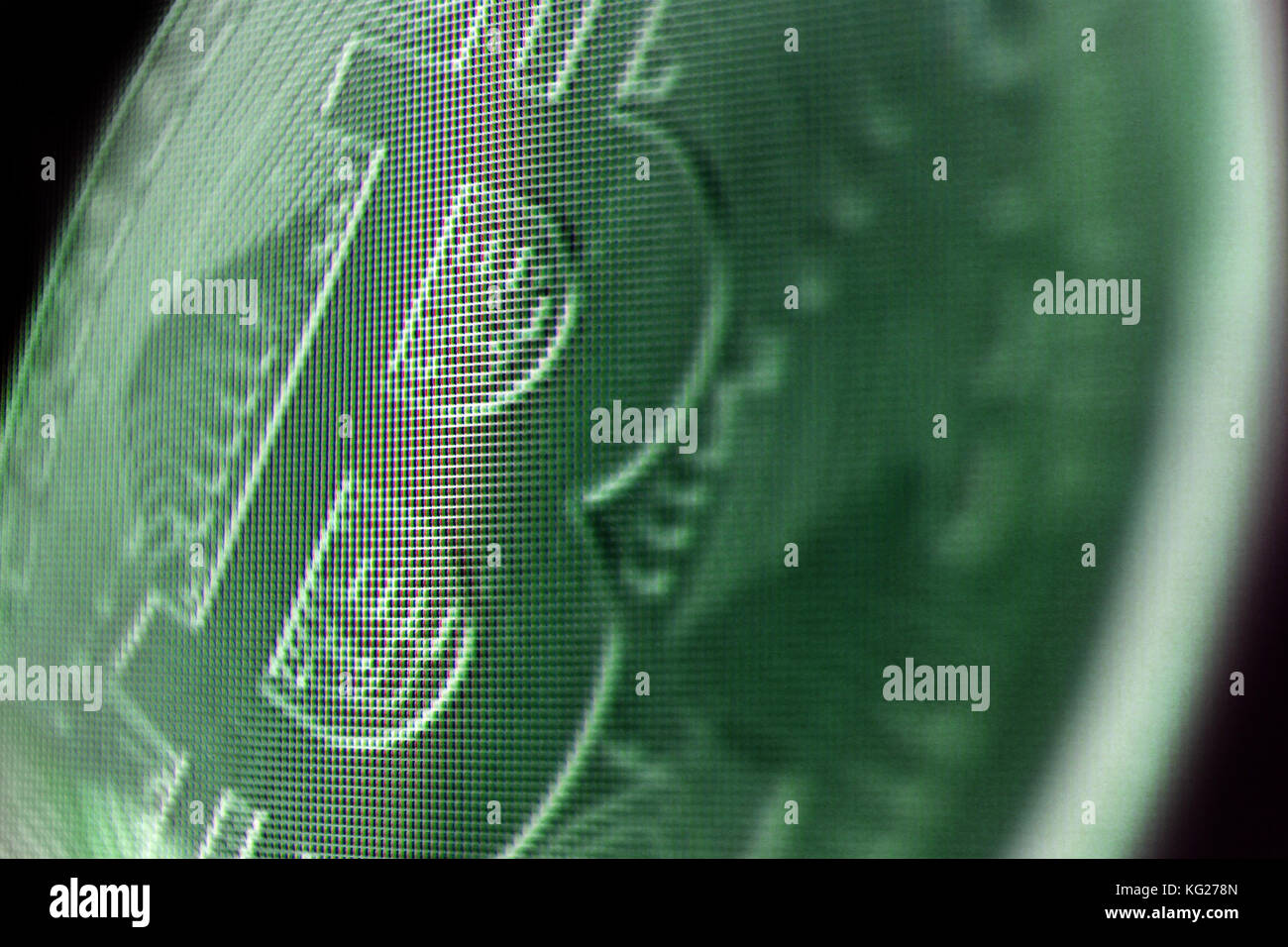 Close-up of bitcoin currency on screen - Stock Image