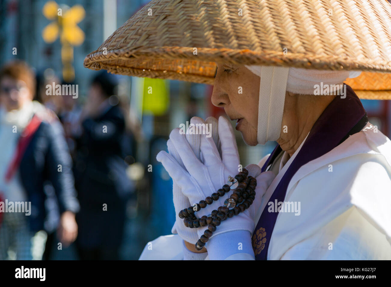 Japanese female Buddhist monk collecting alms at the Kiyomizudera Temple in Kyoto, Japan, Asia Stock Photo