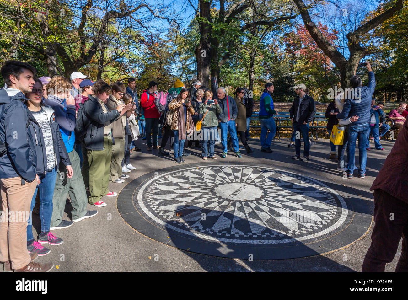 Tourists surrounding the Imagine mosaic at the Strawberry Fields memorial to John Lennon, Central Park, New York - Stock Image