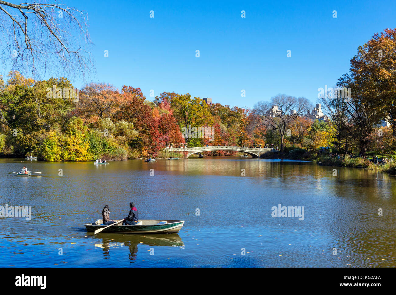 Boating on The Lake in Central Park looking towards Bow Bridge, New York City, NY, USA - Stock Image