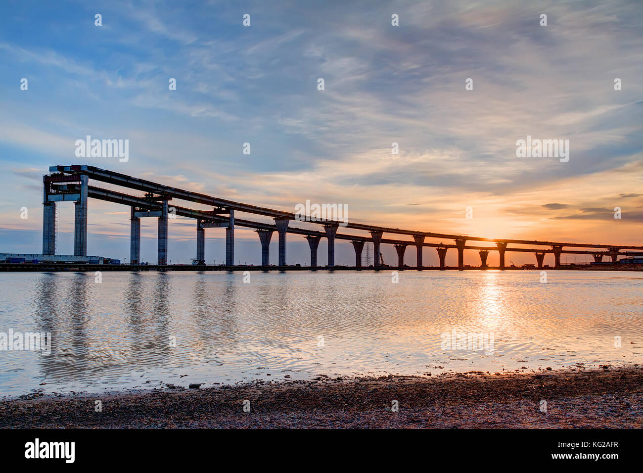 Construction of the Western High-Speed Diameter on the background of beautiful sky at sunset Stock Photo
