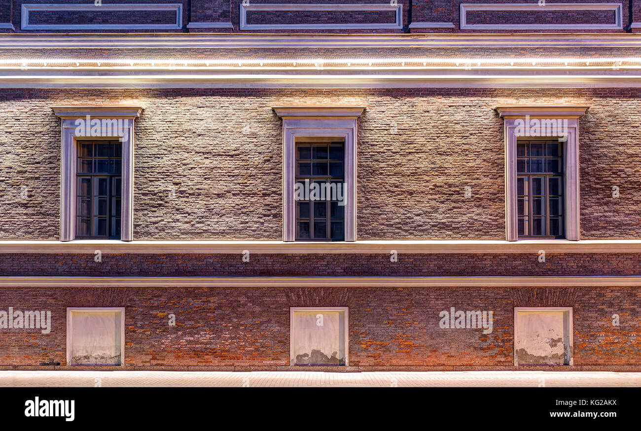 Several windows in a row on night illuminated facade of Central Naval Museum front view, St. Petersburg, Russia Stock Photo