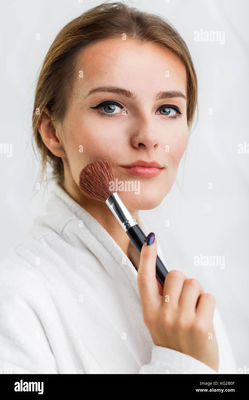 Girl Uses Makeup Brush - Stock Image
