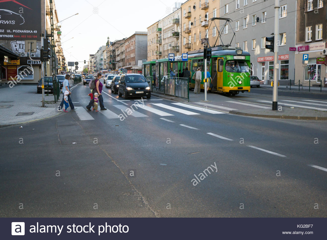 People on the zebra crossing at the busy Glogowska street in Poznan, Poland Stock Photo