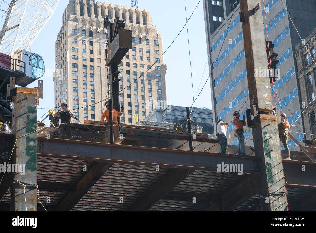 Hi-Rise Construction with tradesmen in Midtown Manhattan, NYC, USA - Stock Image