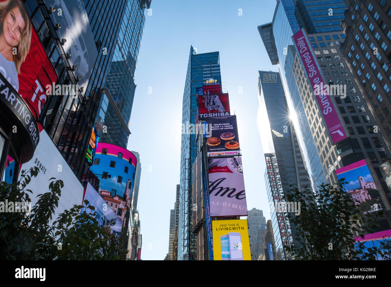 Colorful electronic advertising screens in Times Sq., New York City, USA - Stock Image