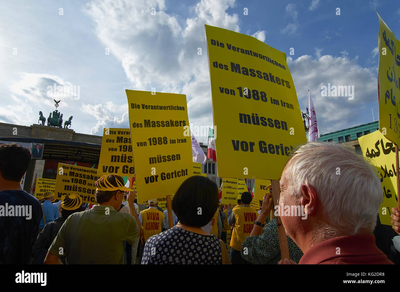 People protesting tp remember The 1988 Massacre of political prisoners in Iran, Berlin, Germany - Stock Image