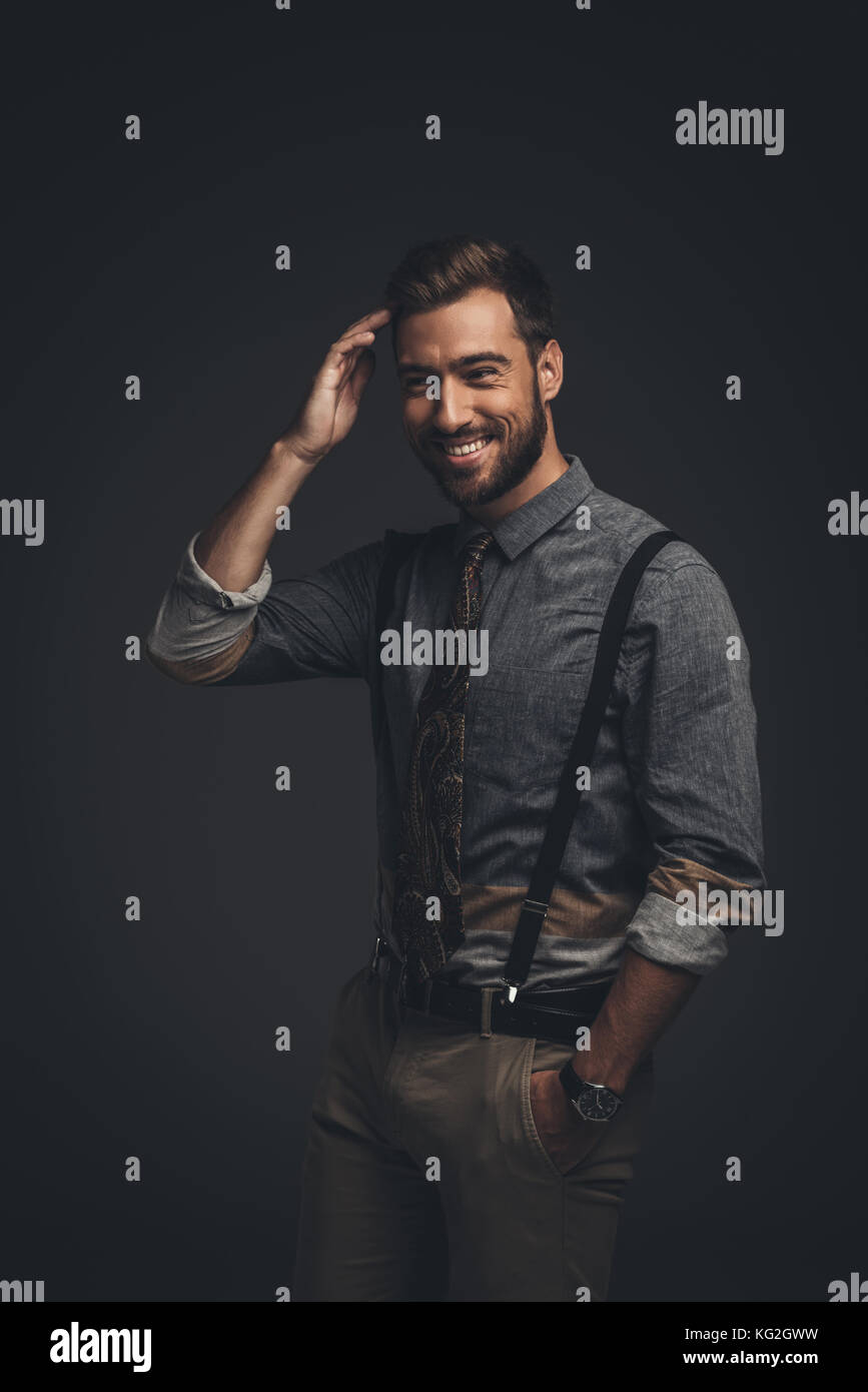 Smiling man in suspenders - Stock Image