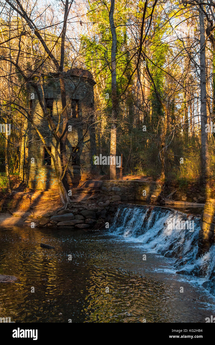 Spillway waterfall and the tower in the Lullwater Park, Atlanta, USA Stock Photo