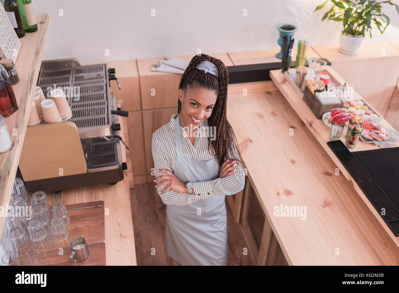 barista posing with arms crossed - Stock Image