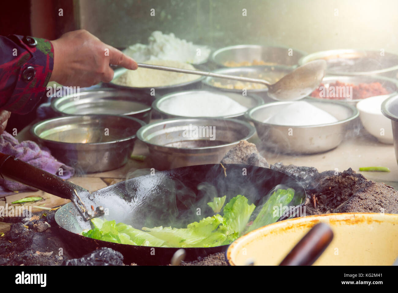 Fried vegetable in a pan , Sichuan street food in chaina Stock Photo