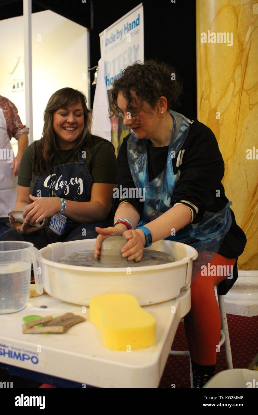 Visitors having a go at pottery at Cardiff's 2017 Made By Hand Pottery Showdown inspired by the TV show. - Stock Image