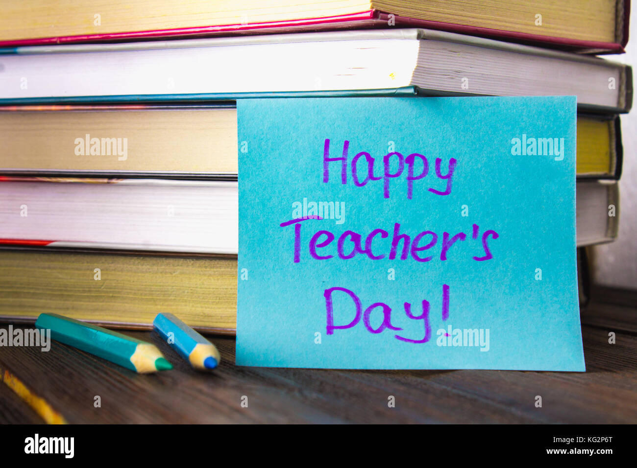 Objects On A Chalkboard Background Books Green Apple Plaque Happy Teachers Day Pencils And Pens In Glass Sprig With