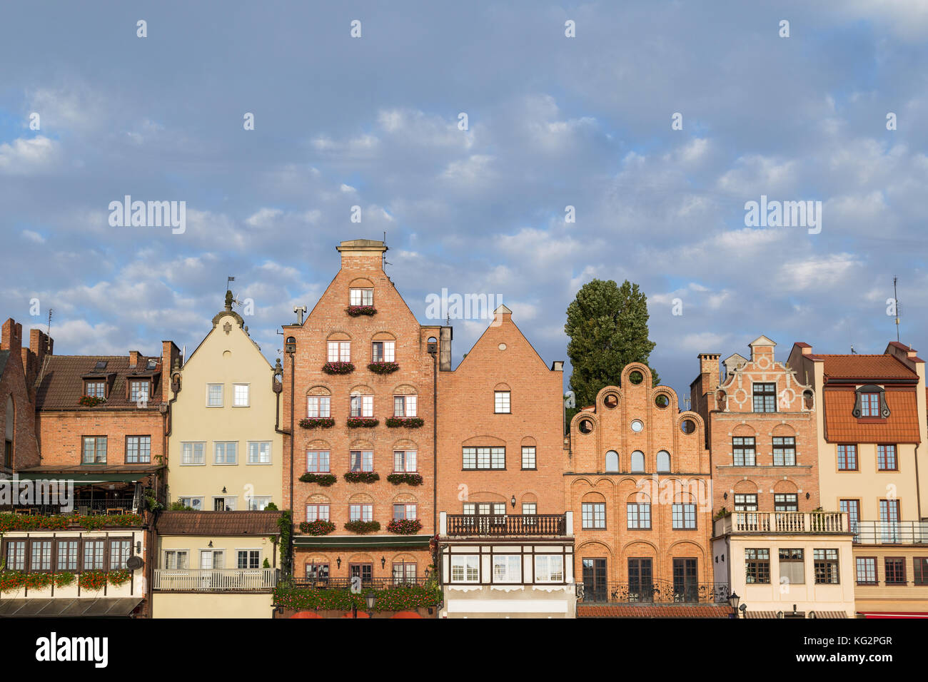 View of old buildings along the Long Bridge waterfront at the Main Town in Gdansk, Poland, in the daytime. Copy - Stock Image