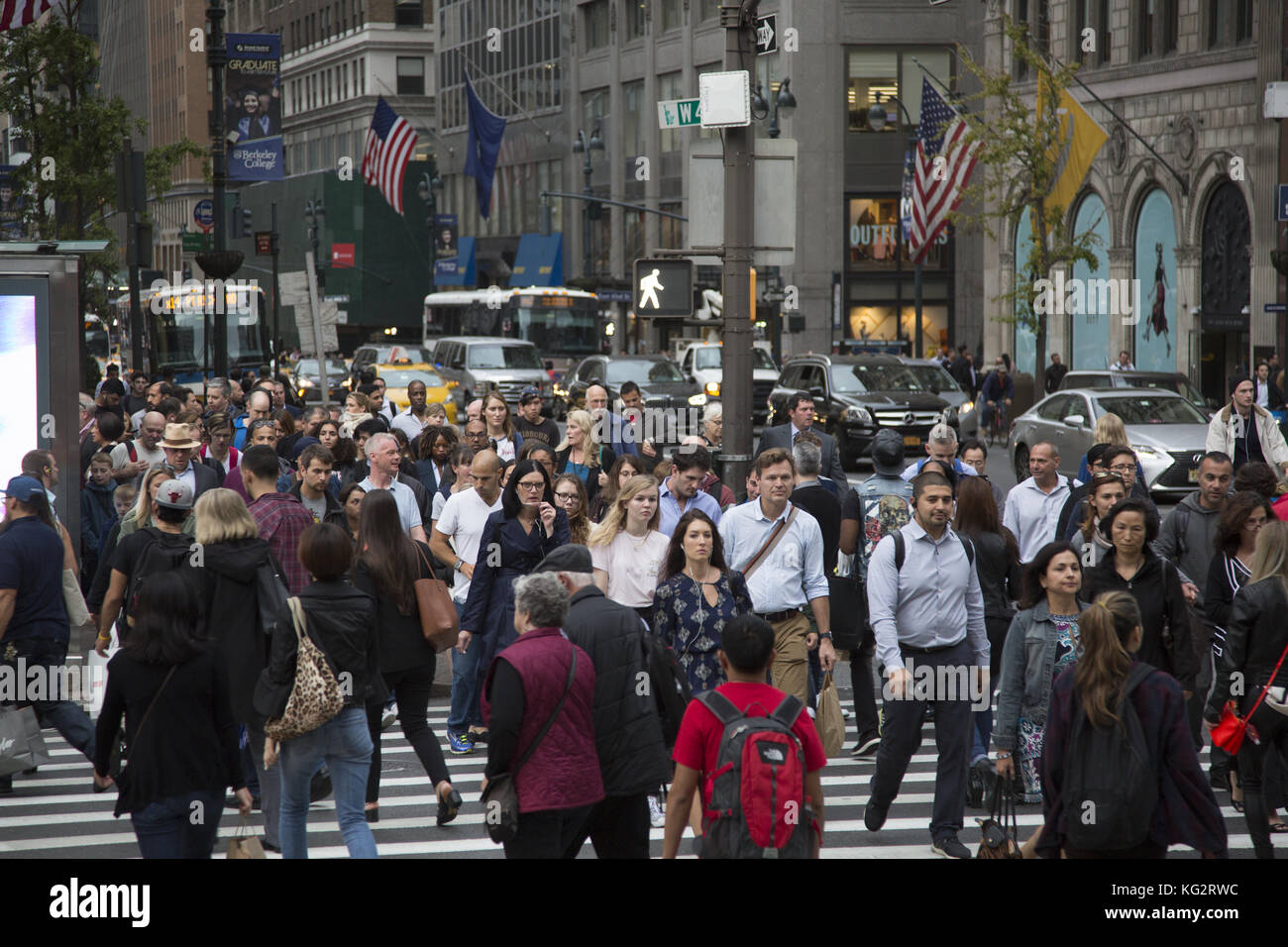 5th Avenue and 42nd Street is one of the busiest street crossings in New York City especially at the evening rush - Stock Image