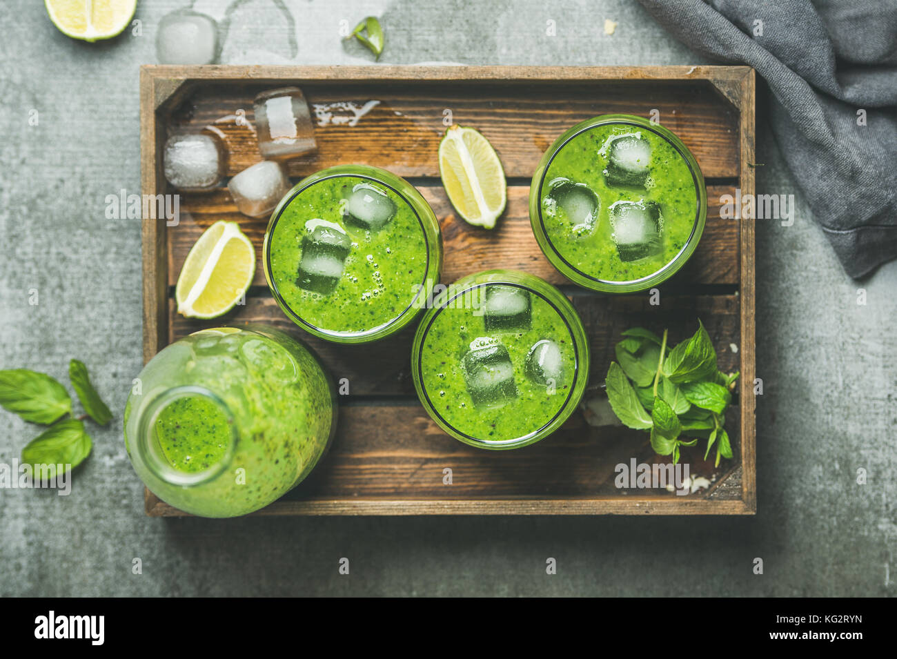 Fresh green smoothie with ice cubes, mint, lime in tray Stock Photo