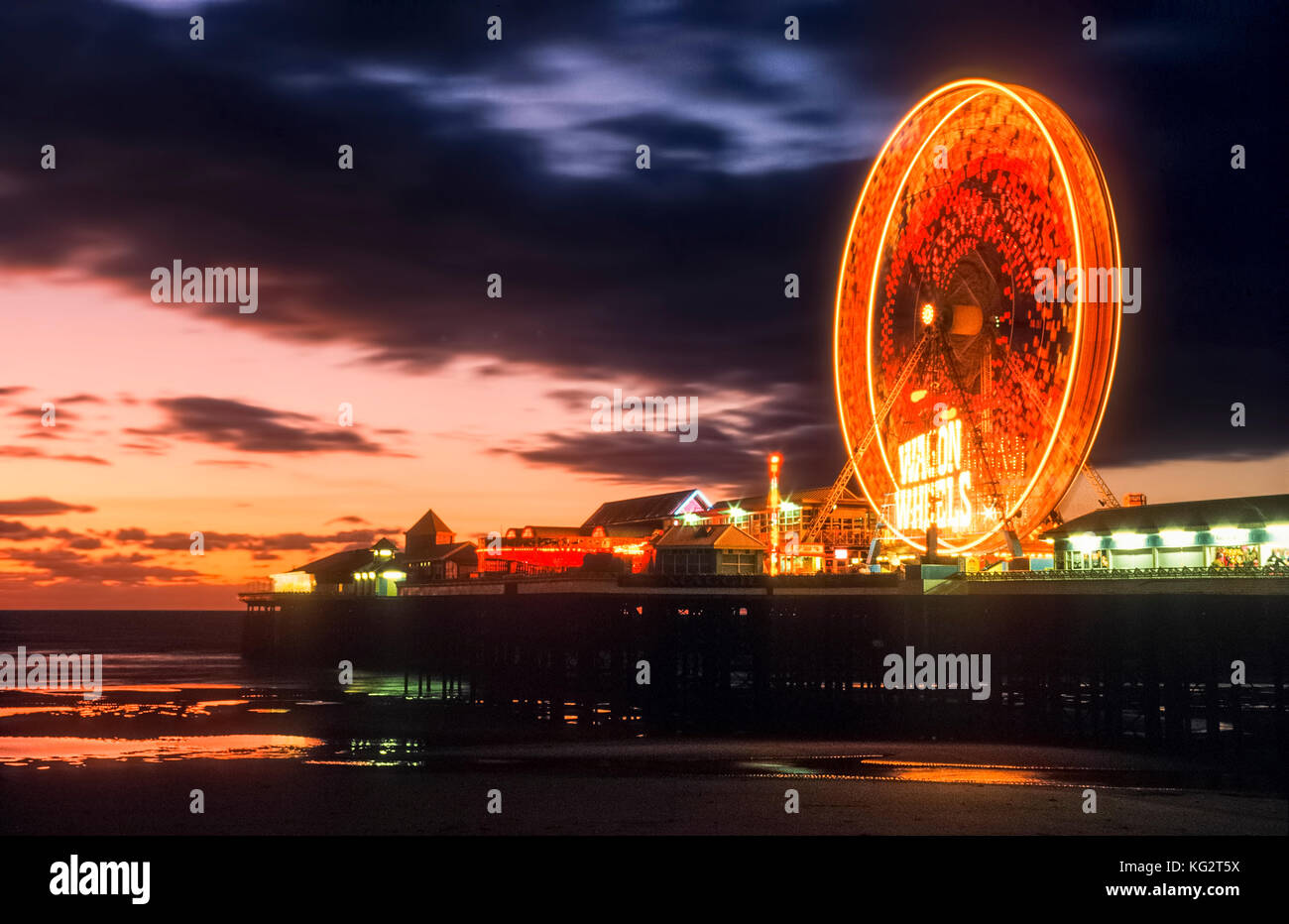 Ferris wheel on the Central Pier at Blackpool at sunset - Stock Image