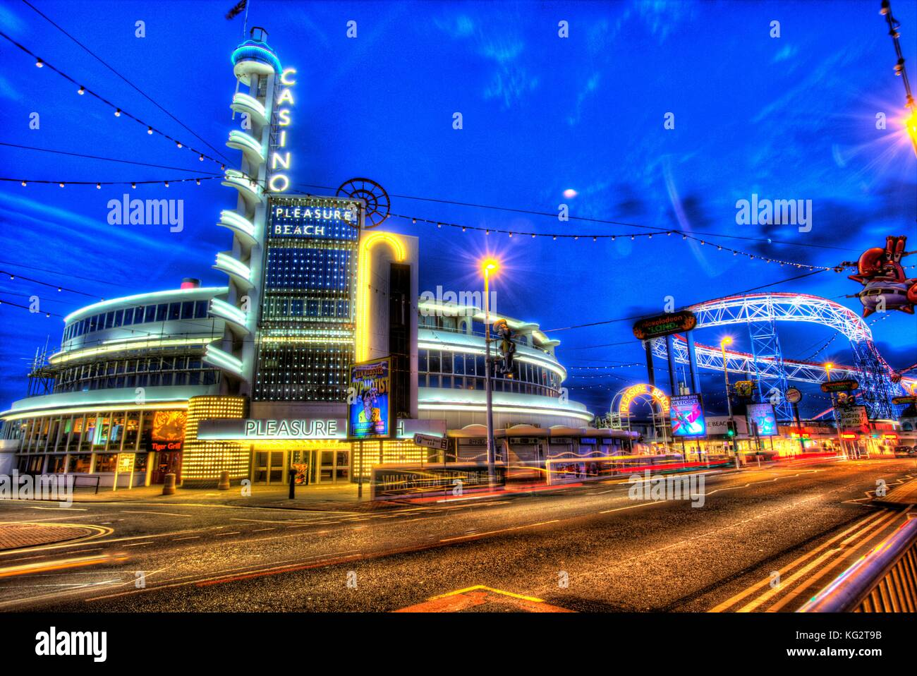 Town of Blackpool, England. Artistic night view of Blackpool Pleasure Beach at the junction of the Promenade and - Stock Image