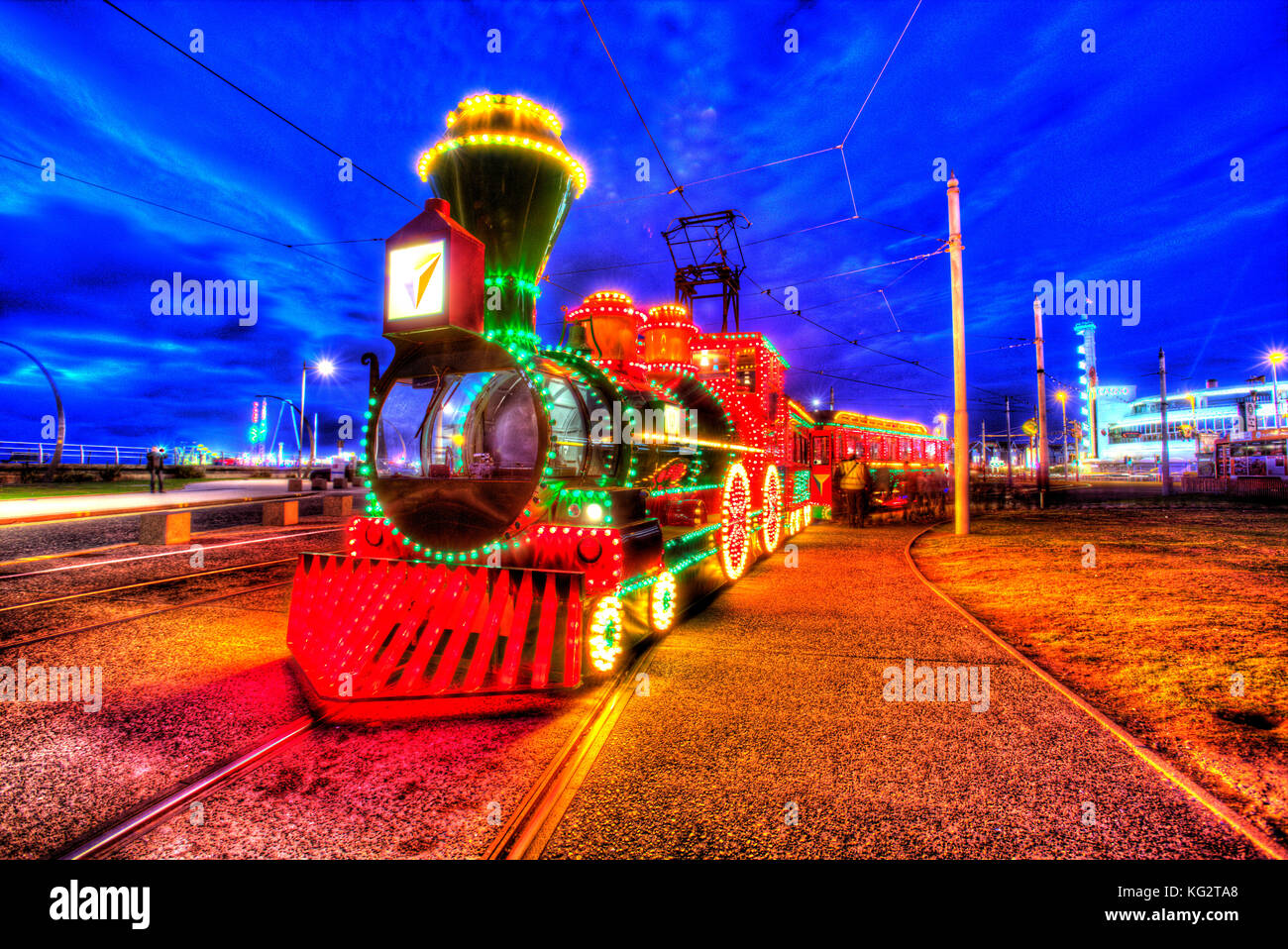 Town of Blackpool, England. Artistic night view of the illuminated trams, during the Blackpool Illumination festivities, Stock Photo