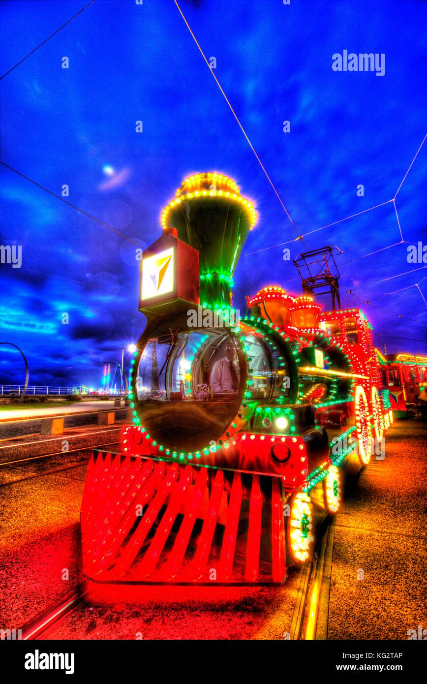 Town of Blackpool, England. Artistic night view of the illuminated trams, during the Blackpool Illumination festivities. Stock Photo