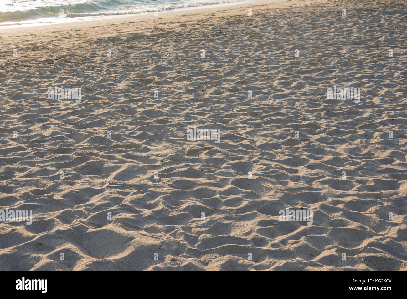 Waves of beach sand texture and background. - Stock Image