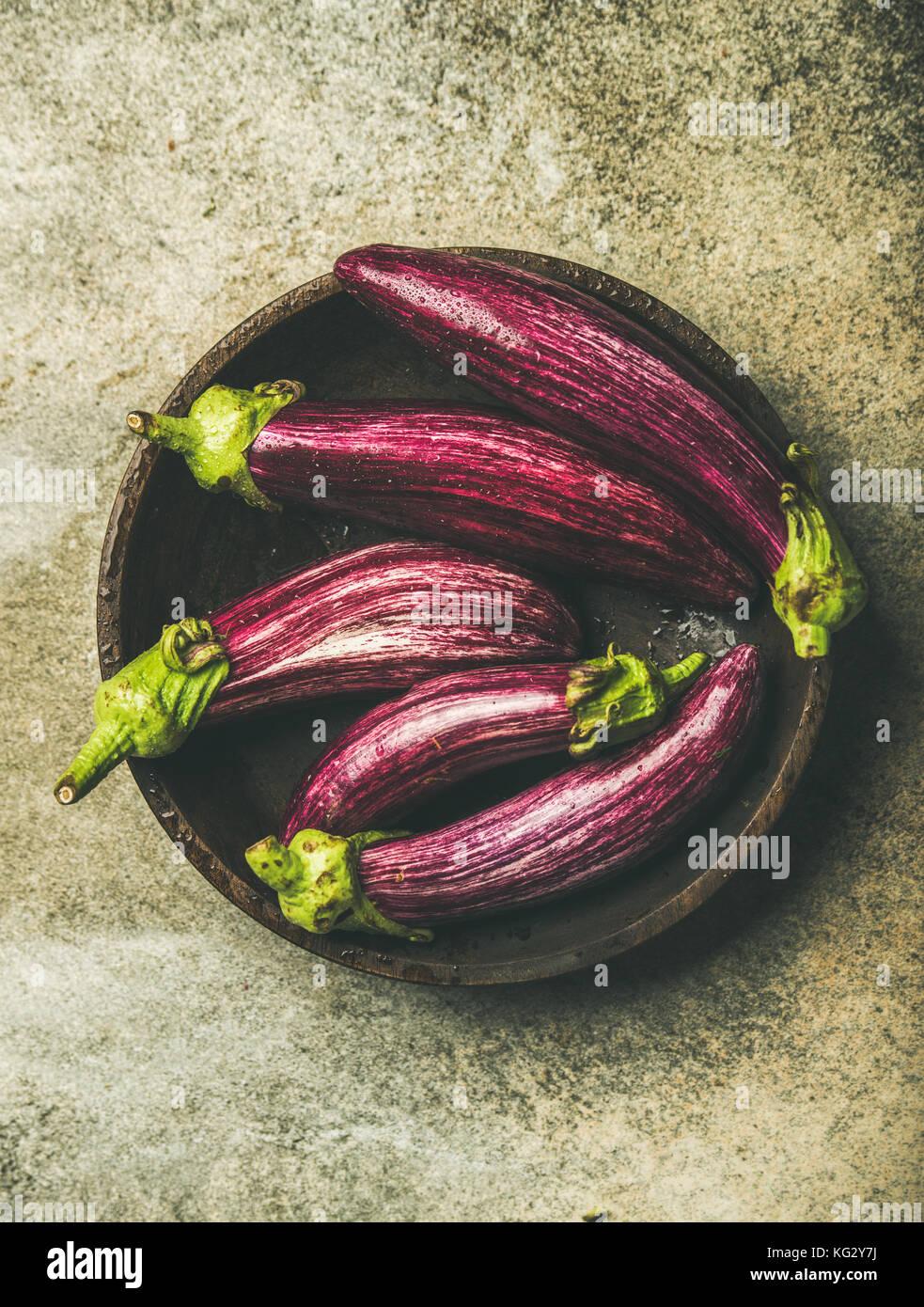 Flat-lay of fresh raw Fall harvest purple eggplants or aubergines - Stock Image
