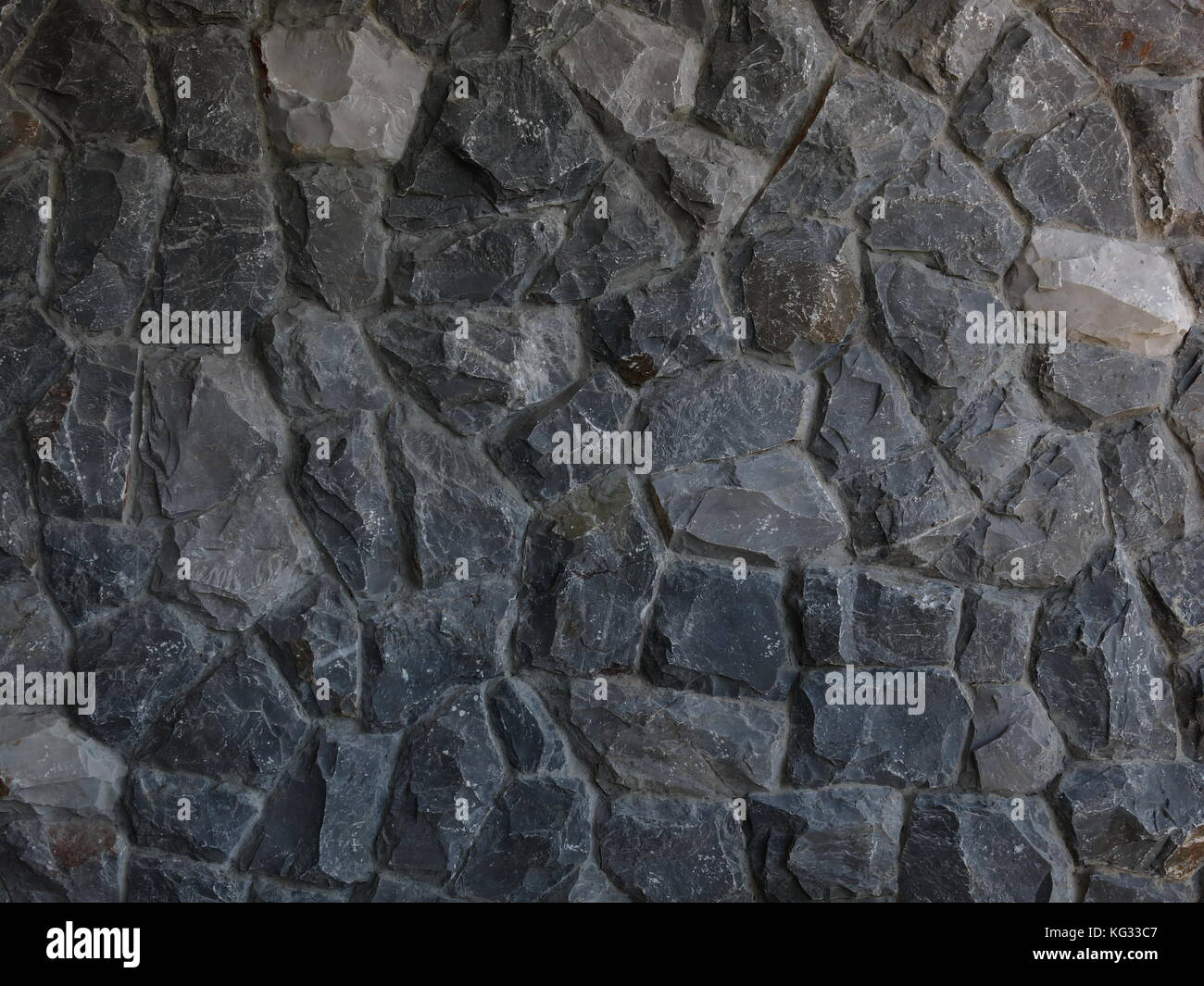 dirty natural dark grey brown rock or stone pattern finishing texture for architectural design and construction. - Stock Image