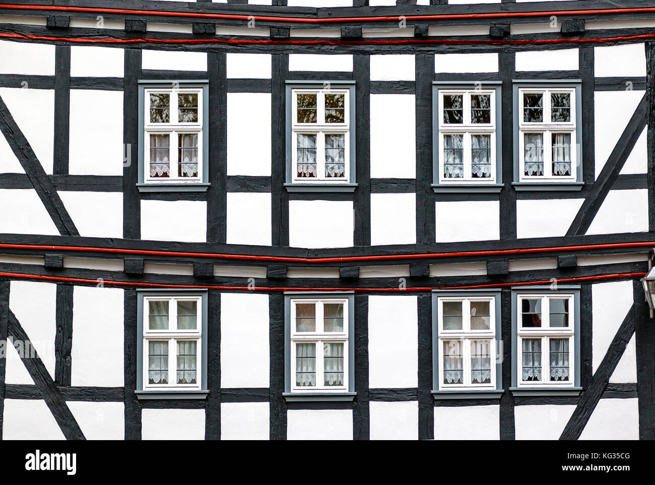 Historic black-and-white half-timbered house in medieval small town of Schlitz Vogelsberg, Germany - Stock Image