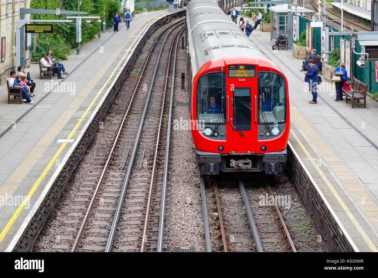 London, UK - October 23, 2017 - West Brompton underground station platforms, with northbound train arriving - Stock Image