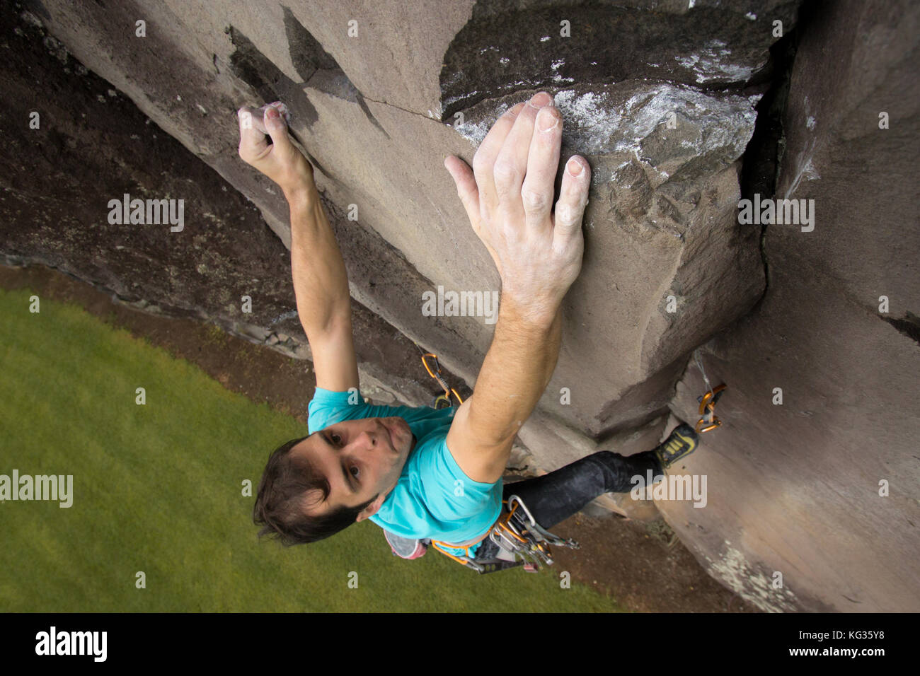 James Field-Mitchell topping out on 'Wendy Kroy', grade 26, Mt Eden Quarry, Auckland. - Stock Image