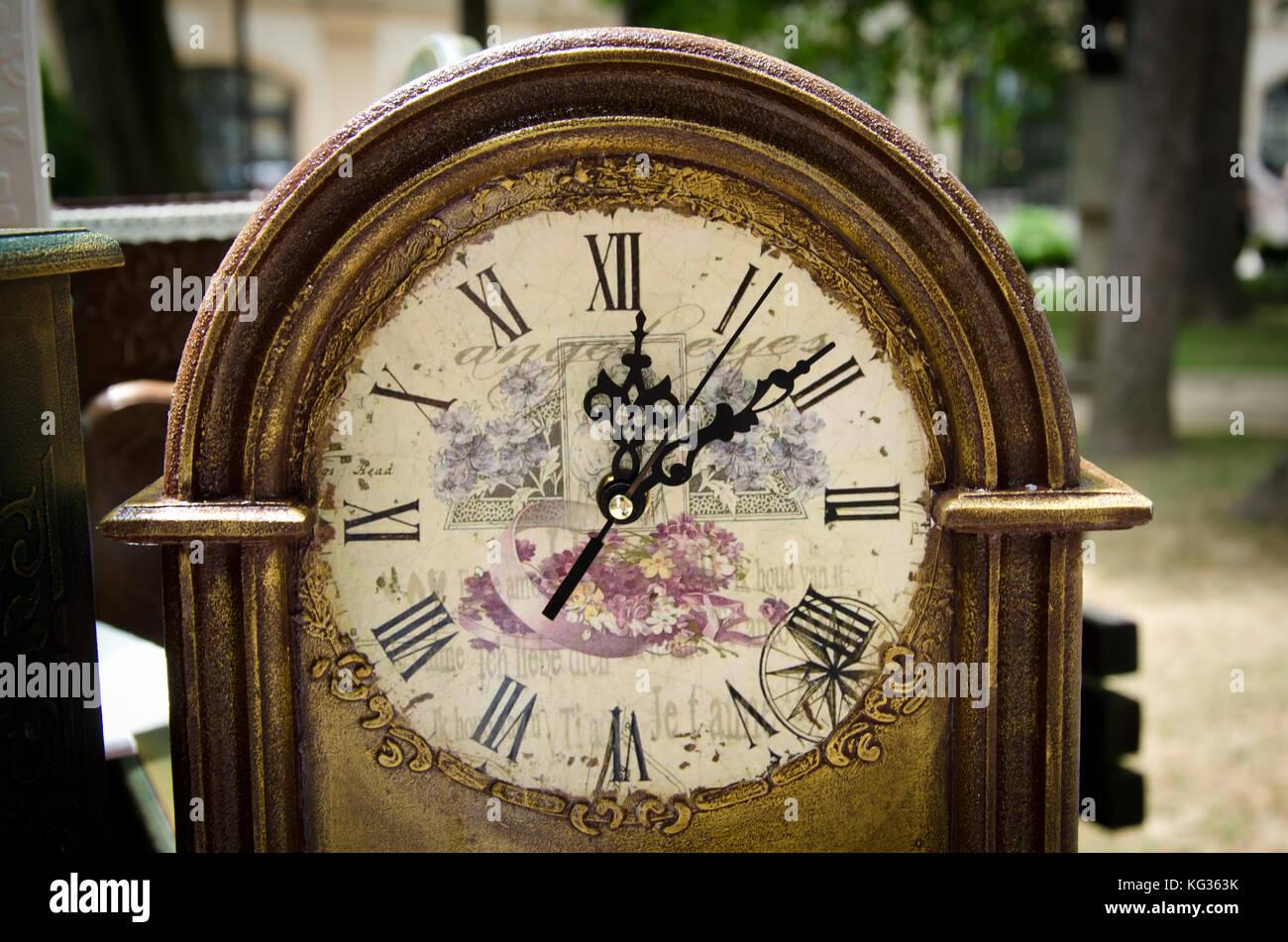 ornamented antique clock close up - Stock Image