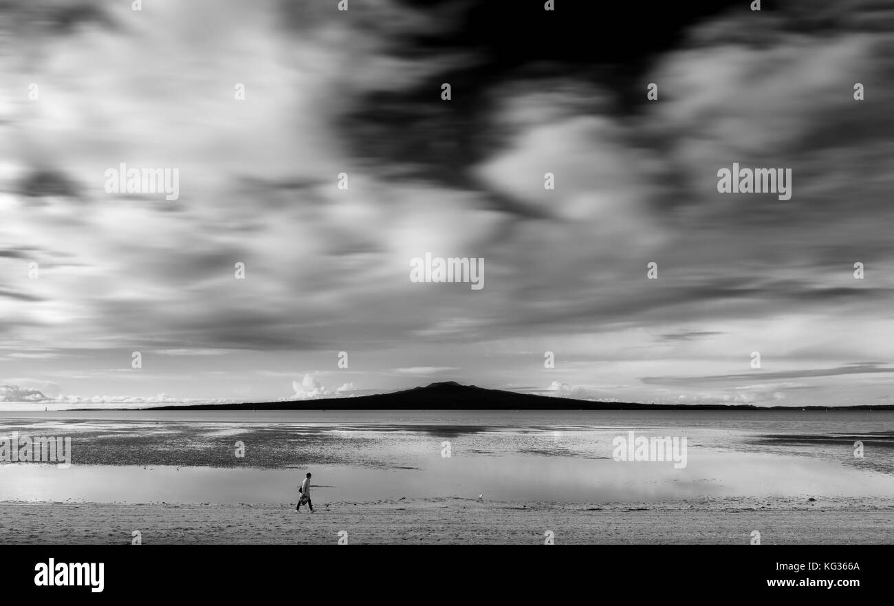 A stroller at Devonport with Rangitoto in the background, Auckland, New Zealand - Stock Image